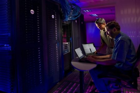 men fixing servers